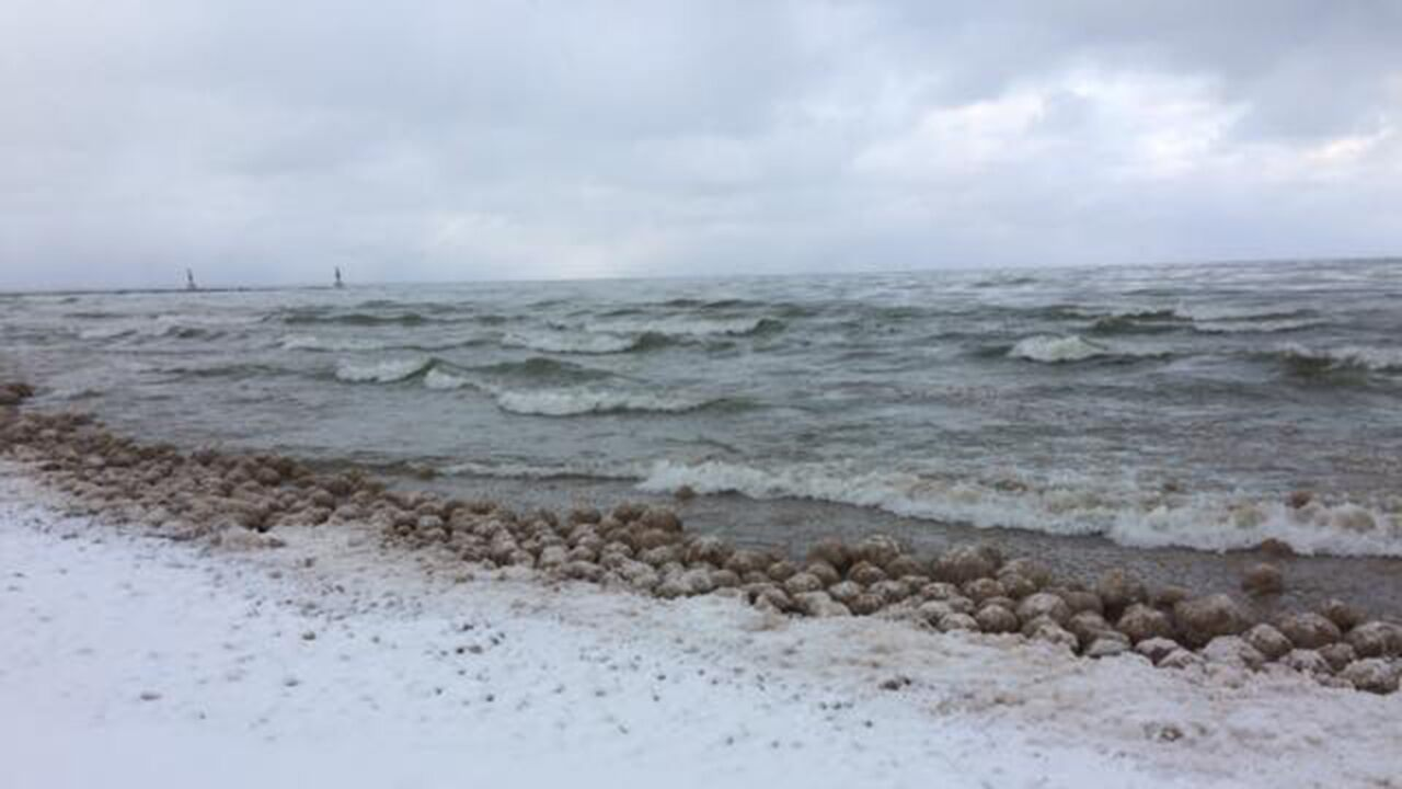 Ice balls appear on Lake Michigan beach, wash up 'by the thousands'